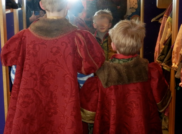 The boys admire their 16th Century selves in a handy mirror.